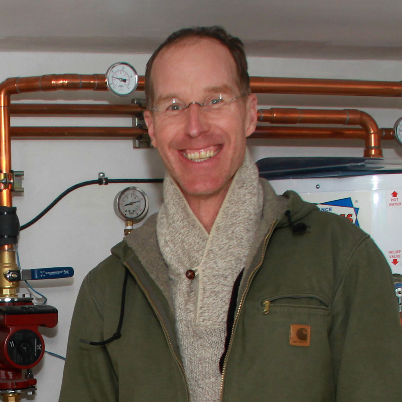 John Jesse in front of one of his earlier and favorite hot water boiler projects. Picture by Manny Becerra